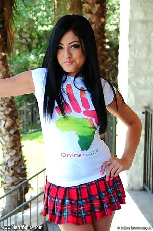 Charming Latino young Cierra Spice takes off her appealing schoolgirl outfit