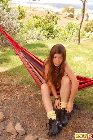 Teen adolescent diva posing unclothed outdoors