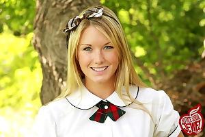Moist young in super stunning schoolgirl outfit smiles and shows her perspired body