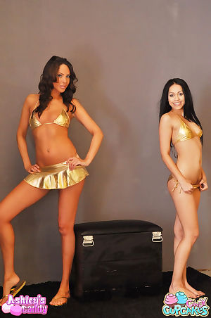 Twofold babes in shiny gold bikinis undress and stroke their extreme infant love bubbles and anuses