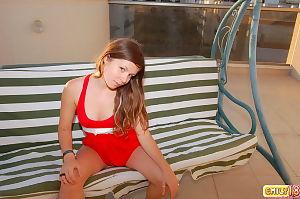 Seductive juvenile chicita in short red suit