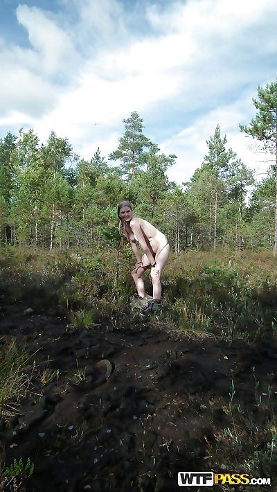 Outdoor posing with nice-looking young hottie showing her anus in woods - part 2