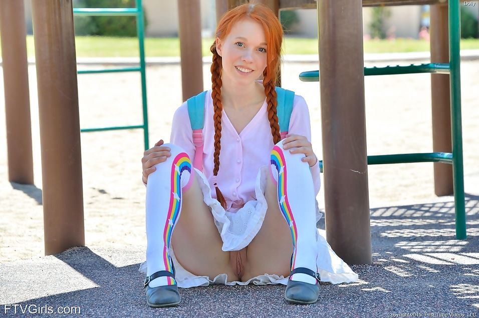 Adolescent redhead in pigtails flashes bawdy cleft at the playground & toys in socks