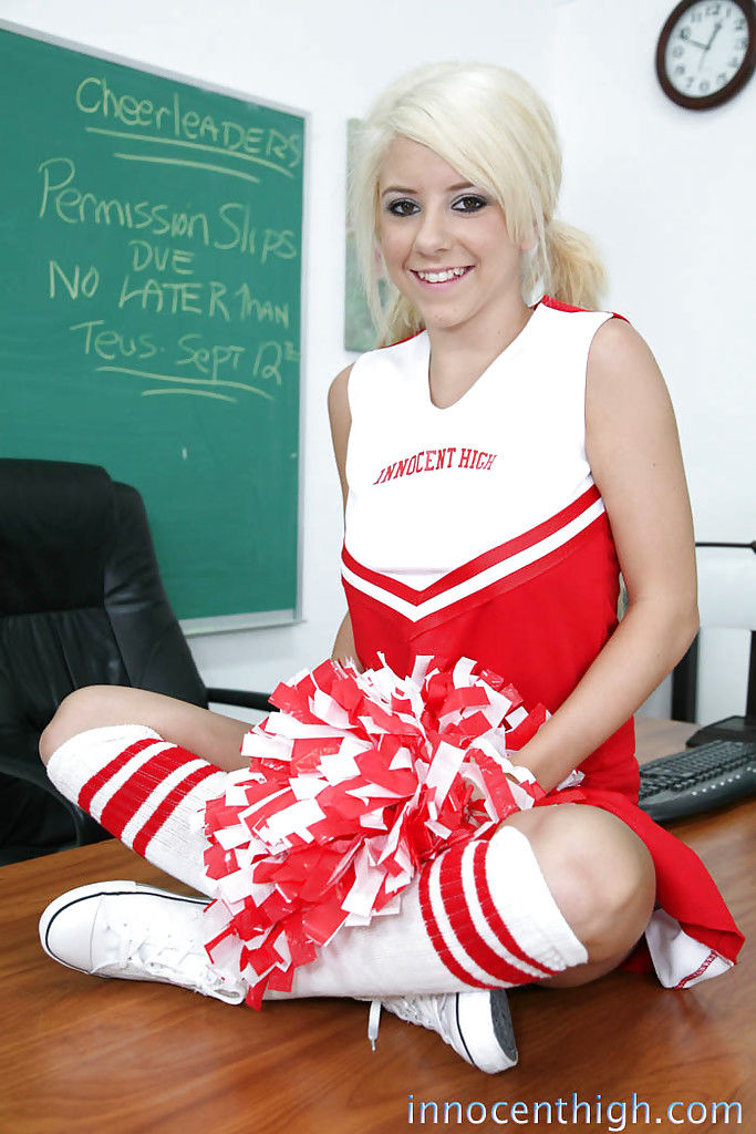 Fairy-haired young Tessa Taylor shows major milk cans in cheerleader uniform
