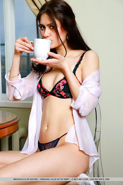 Russian adolescent Megan Elle removes clothes off her underclothes and socks afterwards a cup of tea