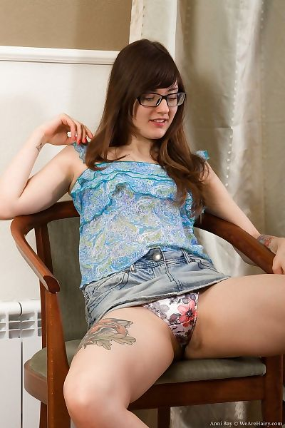 Nerdy adolescent hotty Anni Bay parts her curly snatch wide free later disrobing
