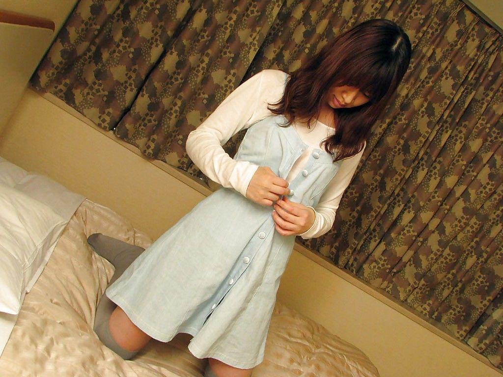 asian teen in nylon knee socks undressing and exposing her