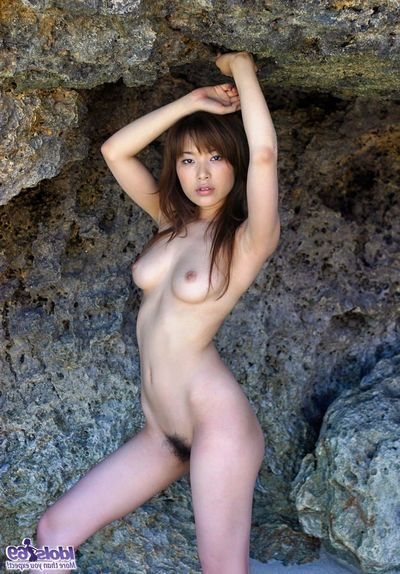 Enjoyable Oriental beach bunny undresses and shows her largest wobblers and sticky gazoo