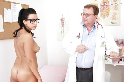 Tattooed dark brown in glasses going during complete gyno exam with dirty doctor