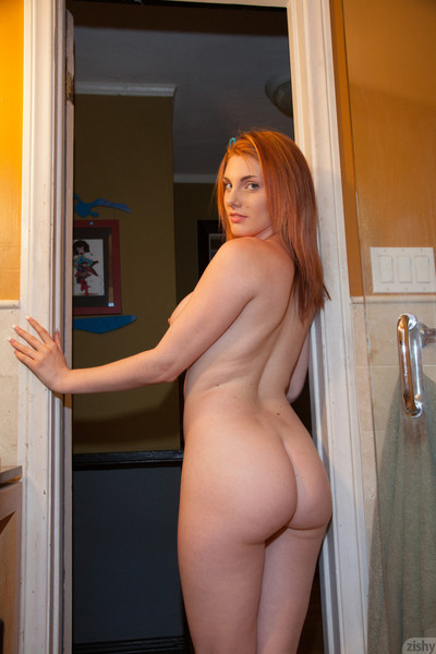 Curvy redhead showering afterward gym