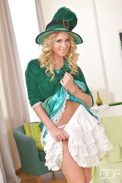 Golden-haired courtesan Kiara Lord amplifying her uterus in a unproven leprechaun costume