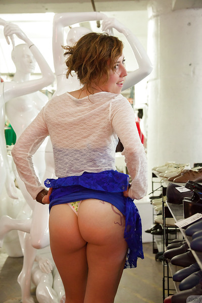 Colossal booty brunette hair young Ursa Finley having enjoyment in a suit store