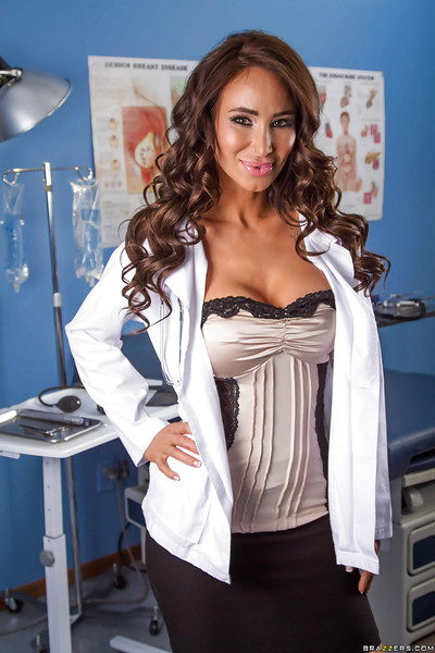 Happy doctor revealing her round boobies and clammy booty in her office