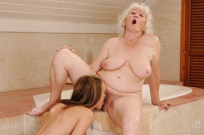 Appealing ripened involves her foxy juvenile partner admires some lesbo act