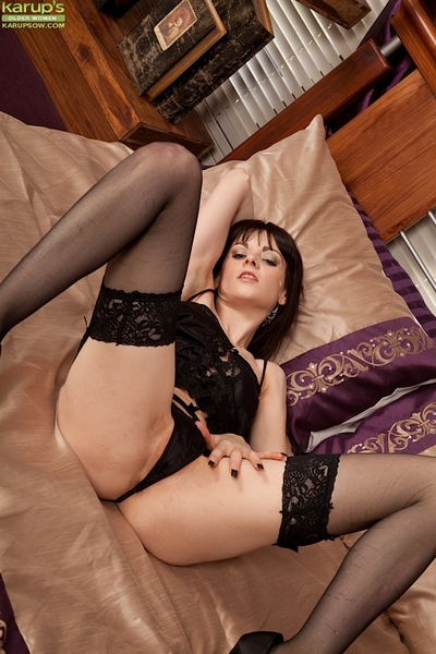 Model milf Vineeta Rose is lying on her daybed and playing with puss
