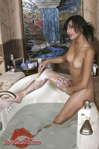 Meager Chinese adolescent angel body shaving legs in shower-room