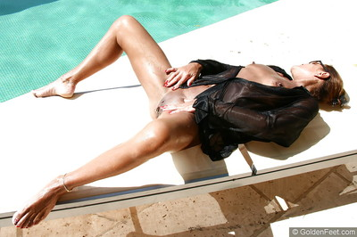 Older UK woman Lady Sarah showing off shiny on top uterus in swimming pool