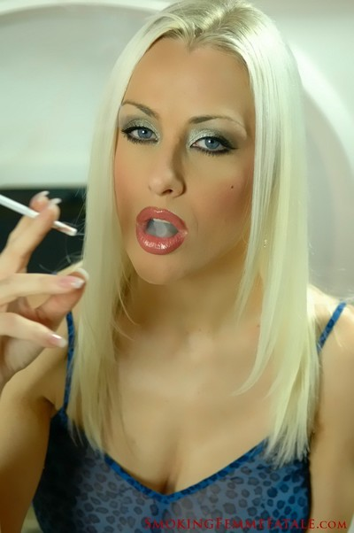 Michelle monroe smokes a thin capri cigarette in a see-thru dominant