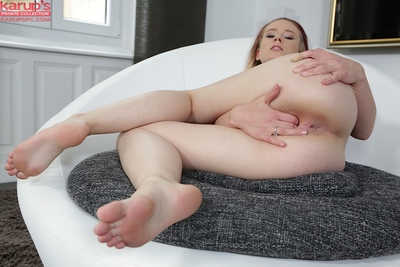 Foxy young with marvelous smile undressing and fingering her soaking twat