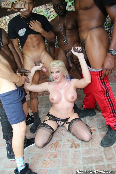 Leya falcon in an interracial group sex scene