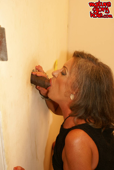 This elderly admires a knob in hermouth on the biffy