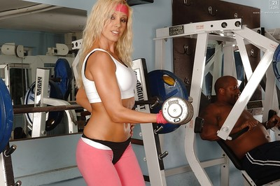 Fairy bodybuilder in pink spandex g-string and brown shorts working out