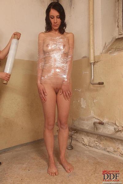 Dark hair girl wrapped in plastic for hardcore infatuation anal dance