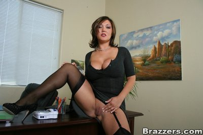 Biggest titted MILF Claire Dames stripped off and rubs muff in her office