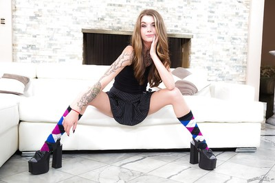 Tattooed queen in socks showing off her adorable shiny on top slit
