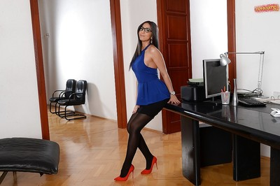 Glasses clothing brown hair Julia De Lucia posing from bottom to top dressed in short skirt and tube