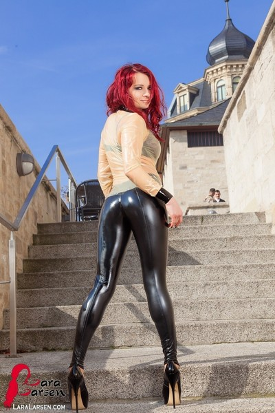 Redhead in shiny latex