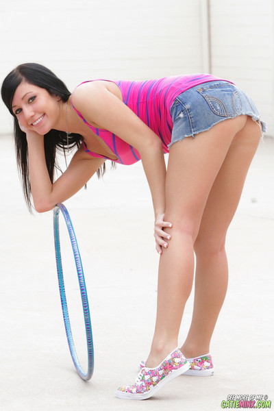 Charming youthful catie minx hula hooping uncovered outside
