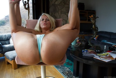 Blond solo doll Layla Price baring fine bumpers and colossal arse