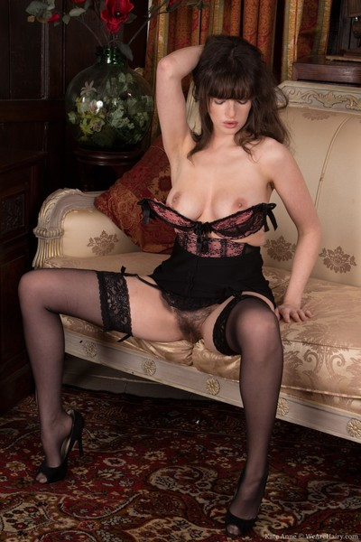 Looking fashionable in her ebon clothing and stockings, Kate Anne is stylish. This chick shows us her 32DD tits halfway admires the pics and then widens her legs to amaze us with her wavy muff and drenched muff lips.