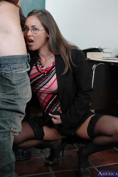 Excited mentor in glasses receives owned and facialized by her hung student