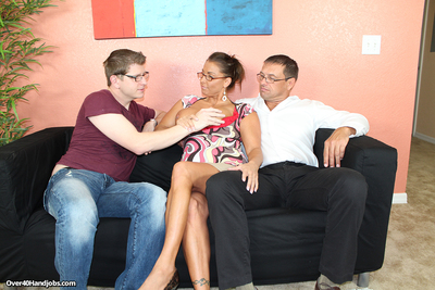 Rounded milf Stacie jacking off her step son and her spouse at the same time