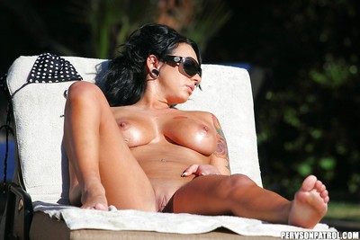 Kitty Bella gains caught on a peeping tom clip tanning uncovered outdoor