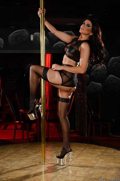 Dark hair stripper Romi Rain removing underclothes around stripper pole