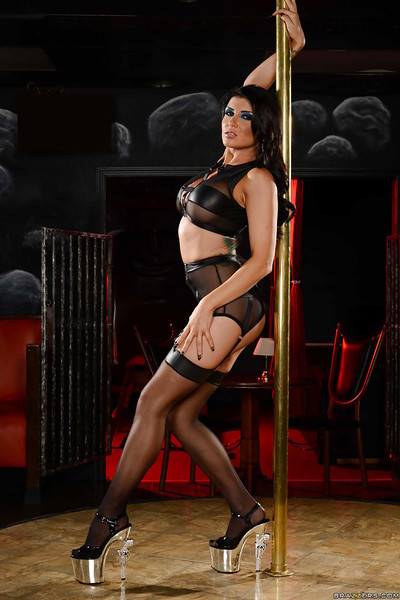 Dark hair stripper Romi Rain removing underclothes around stripper pole