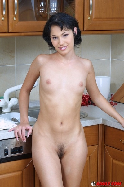 Smiley brown hair cheerleader undressing and exposing her goods in the kitchen