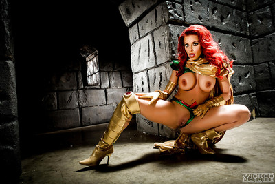 Rounded redhead Britney Amber modeling topless in cosplay outfit