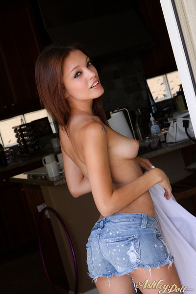 Ashley shows off her splendid melons and love-cage
