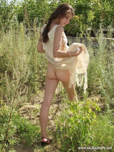 Adolescent exhibitionist plays with her hirsute snatch outdoors
