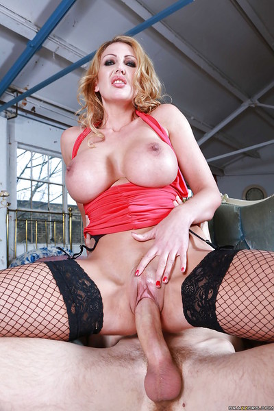 Curvy MILF in fishnets digs a colossal boner and rubs her love button pending this girl squirts