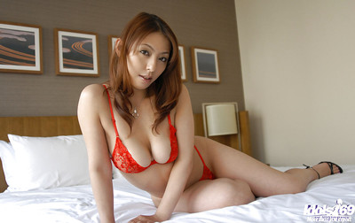 Bawdy Japanese angel with alluring body playing with a dildo