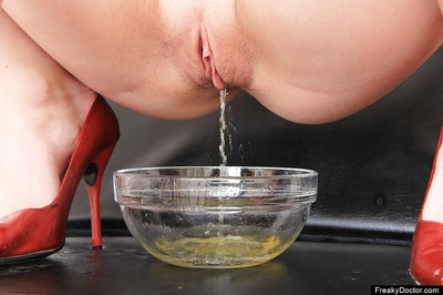 Nice-looking angel Anna eagerly takes her clothes off and makes water in a bowl in gyno room