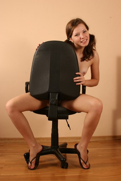 Kimmy making strip-show on a chair