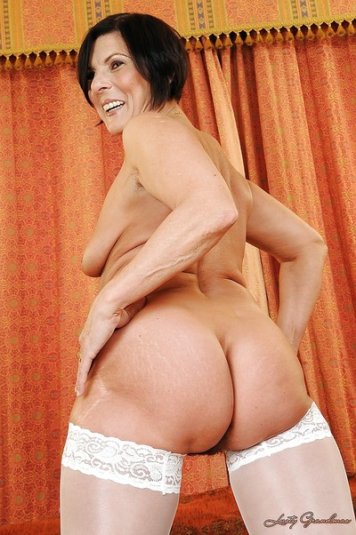 Fatty ripened in white nylons slipping off her lacy underclothes