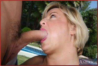 Overweight mamacita with large mounds seducing her well hung gardener at the pool