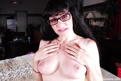 Close up posing features a gigantic love melons dark hair aged Tammy in glasses
